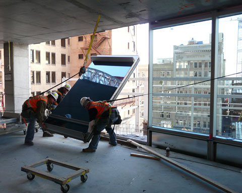 Unitized curtain wall installation.